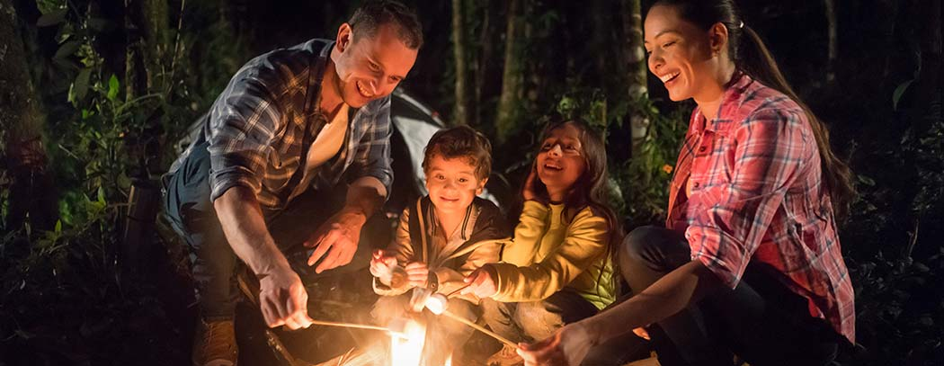 Camping family making s'mores